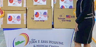 Dyma Williams, interim CEO of the Gov. Juan Luis Hospital, looks over a donation of 20,000 surgical masks from Taiwan. (Photo submitted by JFL Hospital)