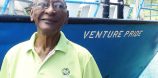 In a 2012 photo, Rodney Varlack stands in front of one of his vessels, Venture Pride. (St. John Tradewinds photo)