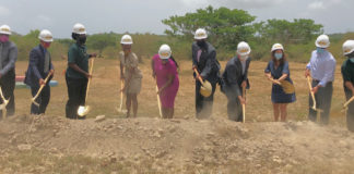 V.I. Government officials and representatives from Fresh Ministries and Farmers in Action turn the first shovels of dirt at the future site of an aquaponics center. (Source photo by Susan Ellis)