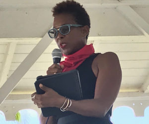 LaVaughn Belle tells the crowd that institutional racism was built over centuries and won't disappear overnight. (Source photo by Elisa McKay)