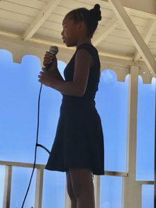 Ochin Diaz sing 'I Am Alive.' (Source photo by Elisa McKay)
