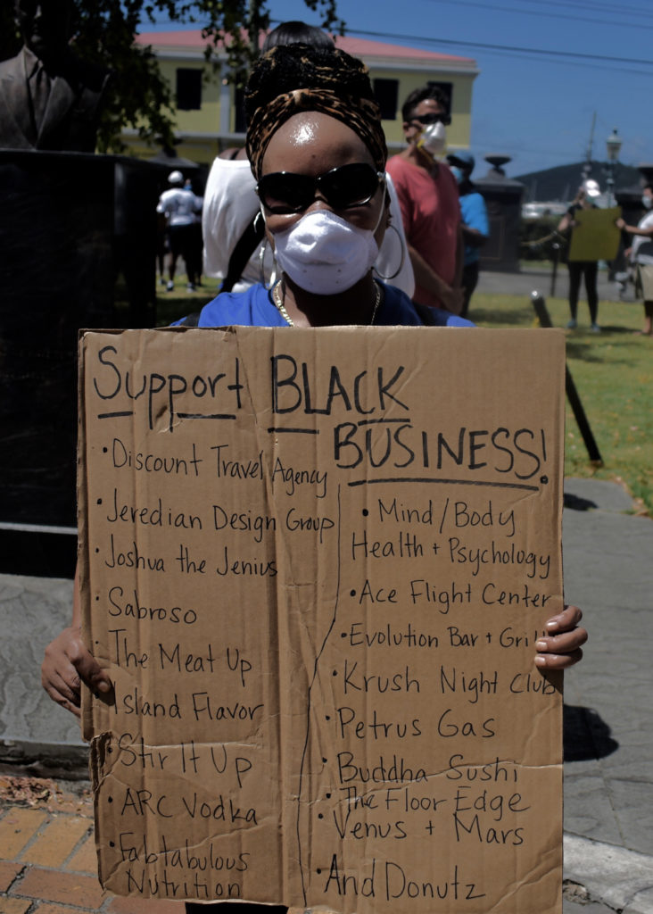 One protester showcases black-owned busisnesses on St. Thomas. (Source photo by Kyle Murphy)