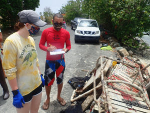 Howard Forbes Jr. and UVI research technician Allie Durdall tally the debris removed from Coki Bay. (Photo submitted by Howard Forbes Jr.)
