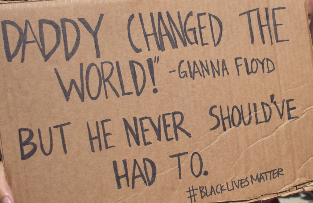"""A sign references a viral video in which George Floyd's daughter says., """"Daddy changed the world."""" (Source photo by Kyle Murphy)"""