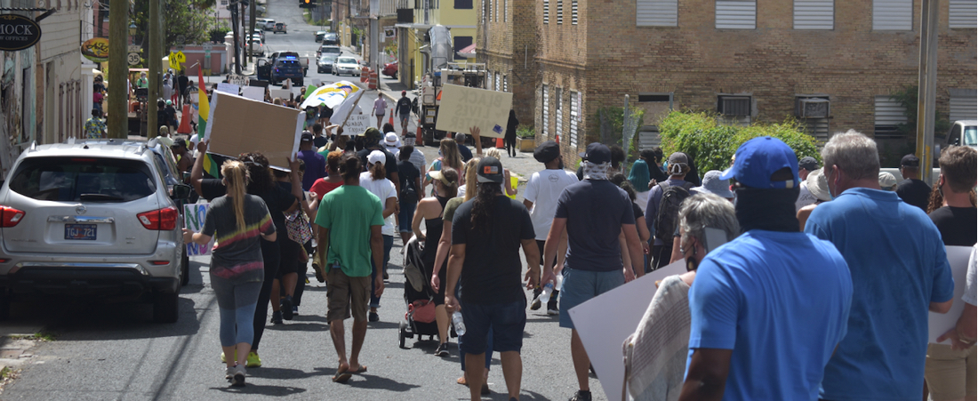 Marchers protesting police brutality and the death of George Floyd at the hands of Minneapolis police pass through Charlotte Amalie. (Source photo by Kyle Murphy)