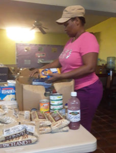 Myrtle Nicholas packs food at the Cruz Bay Seventh-day Adventist Church. Photo provided by Annette Small.