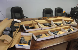 Police display the captured weapons at Tuesday's news conference. (VIPD photo)