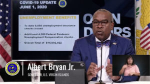 Gov. Albert Bryan, Jr. urges residents to support local police officers as protests reach a tipping point on the mainland.