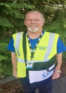 The Census 2020 logo is on the front of both the census taker's yellow vest and blue shirt. (Submitted photo)