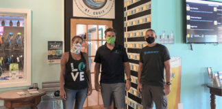 Ivy Hunter, Aaron Hutchins and David Morales stand at the new Leatherback store front. (Source photo by Susan Ellis)