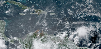 Satellite photo at 12:40 p.m. AST shows a tropical wave, lower right, approaching the windward Islands. (NOAA photo)